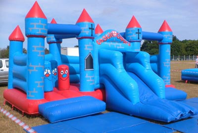 Bouncy Castle with Slide and Biff Bash tubes for hire Lichfield and the surrounding area